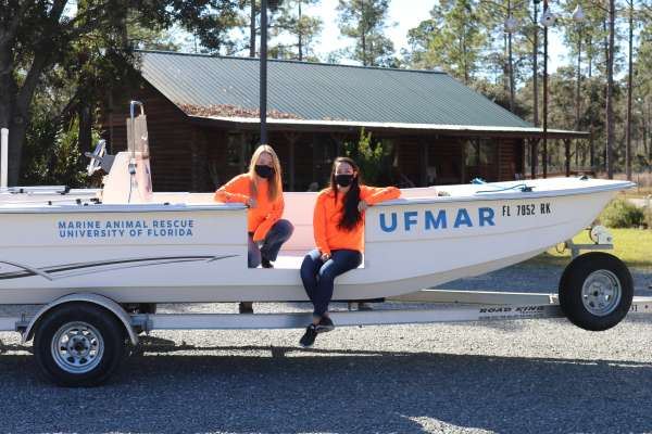 Hannah Walsh and Suzanna Mickey with the Marine Animal Rescue boat